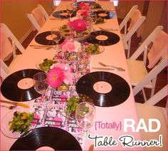 AWESOME idea: use old vinyl as chargers for a fancy dinner.