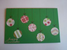 DIY Christmas Card Designs - Green line of baubles on 'string' - cut using a circle hole punch on different patterned paper. Then I drew on the lines from the top using pen and a bow shape, then stuck an outline sticker to the top to look like they're hanging - Happy Christmas Upcycle Craft Card Design Ideas