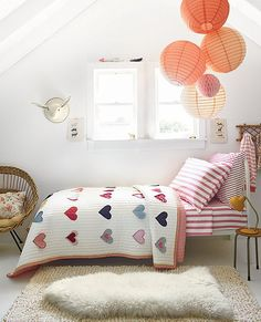 colorful lanterns, hearts on the bed and a furry on the ground for soft landings.  #estella #kids #decor
