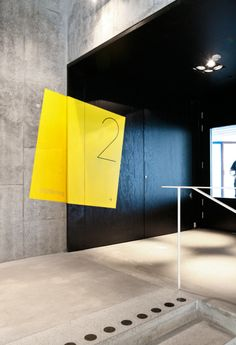 Bold yellow signalisation. #signage #design #wayfinding #square #yellow #floor #two #box #wall