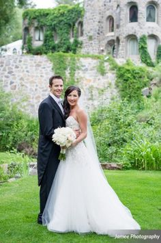 Bride Ashley wearing a Liancarlo wedding gown from Little White Dress Bridal Shop in Denver, CO