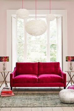 *Pale pink walls, hot pink sofa...love it