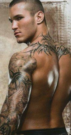 """Angel of Mercy."" Tribal Skulls. Randy Orton. Muscle sleeve. Tattoos, body art."