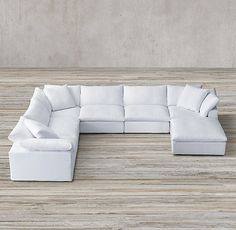 RH's Cloud Modular fabric Sofa-Chaise Sectional:16 STOCKED FABRICS – READYFOR DELIVERY IN 1-2 WEEKSThe world's ultimate sofa, Cloud's modular design nods to the relaxed modernism of the mid-20th century, while its comfort is simply unparalleled. Low frames play clean-lined counterpoint to sink-in, 100% goose feather cushions wrapped in the softest layer of pure down. Easy to customize, three simple slipcovered cubes – corner, armless and ottoman &#8...