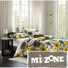 Brighten any bedroom in the house with this colorful floral 4-piece comforter set. The set features bright yellow and gray flowers on a white background with black leaf accents. It comes with a comforter, two matching shams, and a throw pillow.