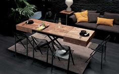 BOX LEGNO, design: Studio Ozeta - Metal frame transformable table, gas adjustable height from cm 25 to cm 84, wooden or natural stone layer covered top and frame, inside extensions. http://www.ozzio.com