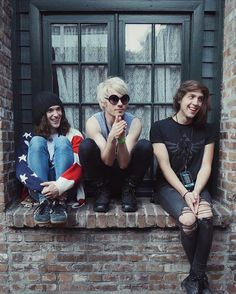 three band members sitting on a wall. three band members sitting on a wall, and if one falls off... then there's hell to pay for whoever pushed them off