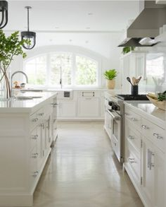 Farmhouse galley kitchen remodel with recessed panel white cabinet and belfast sink