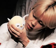 Jiminie playing with plush toy