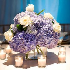 Blue and White Hydrangea and Rose Centerpieces