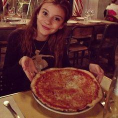 A yummy pizza at a yummy restaurant
