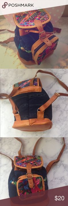 """Denim Aztec leather backpack mini drawstring bag mini backpack  the straps are a little stiff genuine leather trim denim looking softer fabric 9"""" tall 8"""" across 15"""" strap drop at the longest adjustment  will be shipped wrapped in bubble wrap and in a plastic mailing bag  PLEASE CONTACT ME with any questions orconcerns beforeor after a purchase! i am here to help! :) no brand Bags Backpacks"""