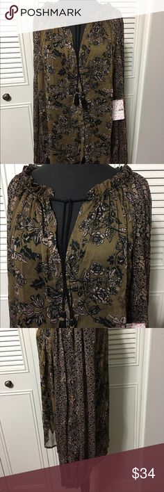 Free People Top NWT Cute nylon Sheer high/lowdeep neck, dangle tie collar and button closure, elastic cuffs top Free People Tops Blouses