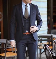Navy blue 3 piece suit, taupe tie and brown belt