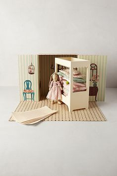 "The Bunny Princess & The Pea Set ""Inspired by a classic fairytale, this whimsical box sets the stage for The Bunny and the Pea, featuring a floppy-eared princess unable to fall asleep in her canopy bed."""