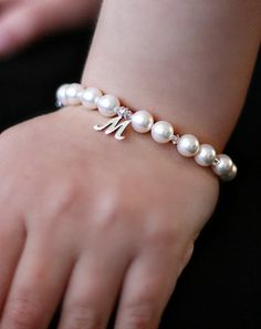 Personalized pearl, swarovski crystal, and Sterling silver initial charm bracelet.