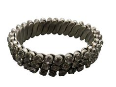 Drift back to a bygone era and let your wrists glimmer in this antique rhinestone bracelet.  Offering simple stretch, for comfortable fit, this preppy slip on bracelet is comprised of sparkling, reflective rhinestones.