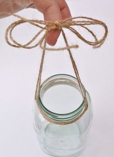 For the Shepard's hooks. Twine wrapped around a mason jar - OPC The Better Half #DIYHomeDecorMasonJars