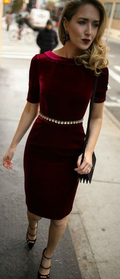 Red velvet sheath dress, embellished black waist belt, black strappy Mary Jane pumps, black leather cross body bag, statement earrings and a dark red lip {Holiday style, Christmas party, what to wear to an office holiday party, office holiday, cocktail attire, festive style, christmas style, holiday 2017 fashion, fashion blogger, classic style}