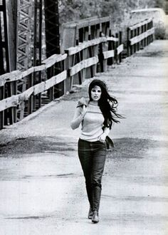 """In this photograph from the November 1967 issue of Life magazine, Bobbie Gentry strolls across the Tallahatchie Bridge in Money, Mississippi. The bridge collapsed in June Bobbie Gentry on the Tallahatchie bridge portrayed in her song, """"Ode to Billie Joe"""" The Animals, Country Music Stars, Country Singers, Country Artists, Bobbie Gentry, Jazz, Music Icon, Life Magazine, My Favorite Music"""