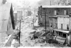 Black Hawk, CO August 12, 1887  Check out this great action shot of the flood waters coming down Gregory St.! I love it how there are people standing on the sidewalk at the left center watching the water!