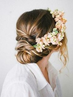 Twisted wedding hairstyle with flower crown / boho chic