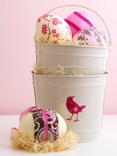 Inexpensive metal pails are a cute and easy way to display colorful Easter eggs. More festive ways to decorate: http://www.bhg.com/holidays/easter/decorating/decorate-with-easter-eggs/?socsrc=bhgpin030513eggpails=15