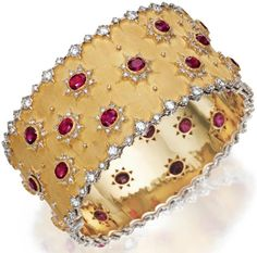 Buccellati gold, ruby, and diamond bracelet. white and yellow gold set with oval rubies within star motifs, accented by round diamonds. Hinged and signed Buccellati, Italy. Diamond Bracelets, Gold Bangles, Bangle Bracelets, Ruby Bangles, Bangle Set, Ruby Jewelry, Bling Jewelry, Sapphire Earrings, Snake Earrings