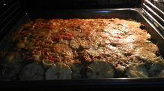 Lasaña de verduras, berenjenas, carne, puerros y tres pimientos,bechamel,calabacín, carne, puerro, tres pimientos , bechamel queso filato...