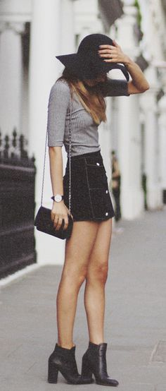 Sonya Esman is wearing a grey top from River Island, a vintage skirt, boots from ASOS, bag from Chanel and a hat from TopShop