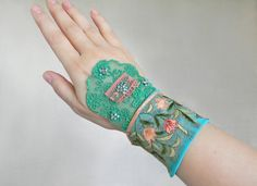 Summer floral silk embroidery wide cuff bracelet with Toho beads in green turquoise - Shabby chic wrist cuff - Romantic textile jewelry cuff Etsy Jewelry, Handmade Jewelry, Handmade Items, Recycled Fashion, Textile Jewelry, Antique Lace, Etsy Crafts, Bead Crochet, Lace Fabric