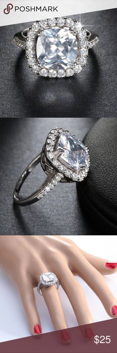 """💍5 Carat Cushion Cut Halo Ring 💍 5 carat AAA Simulated Diamond Cushion Cut fashion Ring. 3 layers of Platinum Plated over White Brass. High polished gives this ring a WOW factor!  Beautiful High quality Austrian Crystal center stone. Wear as an engagement, cocktail, or statement ring. Great for a birthday gift. Wear in place of your """"Expensive"""" ring!  Lead, Nickel, & Cadmium free.  *NOTE: Remember to remove jewelry before direct contact with any water, lotions, and/or perfumes.   *Selling…"""