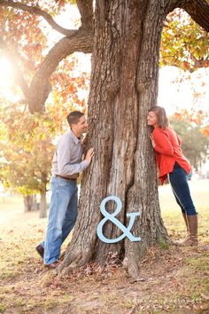 save the date photo ideas. Would be cute with a save the date sign on the tree. … save the date photo ideas. Would be cute with a save the date sign on the tree. Possibly with initials carved into tree? Engagement Announcement Photos, Engagement Photo Poses, Fall Engagement, Engagement Couple, Engagement Pictures, Engagement Shoots, Engagement Photography, Wedding Photography, Country Engagement