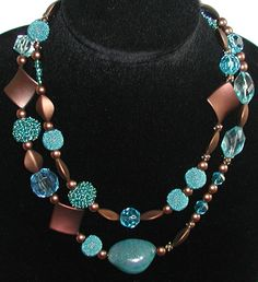 Love, love, love these two colors together.    This pretty necklace is a fun two (2) strand eclectic mix of beads.  Includes acrylic, glass and stone