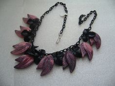 Eye-catchingly elegant black and dark pink-purple celluloid leaf dangle charm necklace.  #vintage #jewelry #necklaces