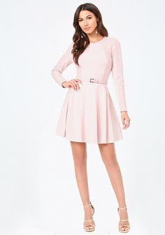 Pretty fit-and-flare dress detailed with chic panels of lace. Detachable patent belt gives it a smart finish. Long sleeves. Hidden back hook-and-eye and zip closure. Partially lined.