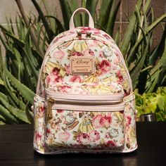 Loungefly Disney Beauty and the Beast Princess Belle Floral Mini Backpack. Ships well packed and padded. Loungefly mini backpacks are approximately (WxHxD in inches). Cute Mini Backpacks, Stylish Backpacks, Girl Backpacks, Disney Handbags, Disney Purse, Cute Purses, Purses And Bags, Mochila Jansport, Cute Disney Outfits