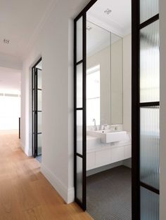 Sliding glass doors can fill your bathroom with light without compromising your privacy.