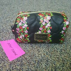 Floral Cosmetic Bag This is brand new with tags, nothing wrong with it, no stains or scratches. It is beautiful and very spacious to put all of your make up! Let me know if you have any questions :) Betsey Johnson Bags Cosmetic Bags & Cases