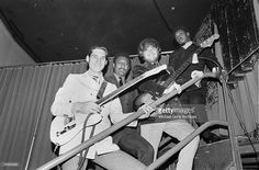 Booker T and the MG's, from left to right, Steve Cropper (guitar), Al Jackson Jr. (drums), Donald 'Duck' Dunn (bass) and Booker T. Jones pose for a photo on their way to perform in the Stax Records Christmas Concert at the Mid-South Coliseum on December 20, 1968 in Memphis, Tennessee.