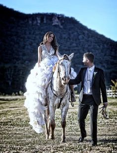 Bride and groom horse ride