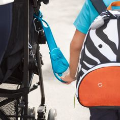 The Skip Hop Walk Along Stroller Handle Teaches Older Children to Stay Close to Mom