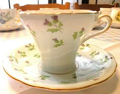 Aynsley Scotch thistle corset cup with sky blue background