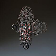 Tamara Grüner Brooch: No 75 Historical metal pieces - blackened, glass, plastic, paint, silver, steel 12,3 x 9,9 x 1,2 cm