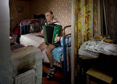 """Frank Herfort captures surreal moments in Russia. His series """"Time In Between – Fairy Tale Of Russia"""" document the bizarre and beautiful contradictions of daily life in Moscow, St. Petersburg and other areas in Russia. Each image is layered with mystery, melancholy, and the absurd. Her"""