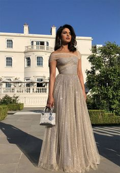 Priyanka Chopra looks like a dream in golden Dior at Meghan Markle-Prince Harry's wedding reception<br> Meghan Markle, Indian Gowns, Indian Outfits, Indian Prom Dresses, Wedding Reception Outfit, Wedding Dresses, Indian Reception Outfit, Reception Party, Prince Harry Wedding