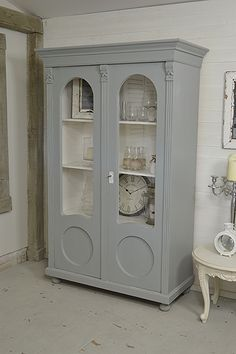 This large rustic Dutch Linen Cupboard or Storage Cabinet comes in original grey paint with F&B All White inside. We've lightly distressed to enhance it's rustic charm. Perfect for storing glassware or as a linen cupboard or bookcase!  https://www.thetreasuretrove.co.uk/cabinets-and-storage/large-rustic-shabby-chic-linen-cupboard-display-cabinet #shabbychicfurniture #vintagefurniture