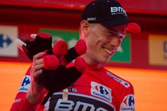 BMC Racing Team's Australian cyclist Rohan Dennis smiles on the podium as he celebrates winning the first stage of the 73rd edition of 'La Vuelta' Tour of Spain cycling race, an 8 km individual time trial from Malaga to Malaga, on August 25, 2018. (Photo by JORGE GUERRERO / AFP)        (Photo credit should read JORGE GUERRERO/AFP/Getty Images)