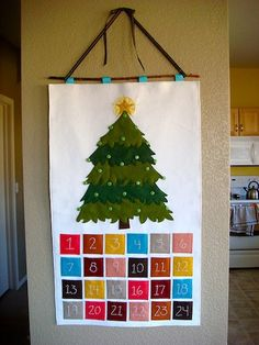 Pull the felt ornaments out of the pockets and place on the tree.