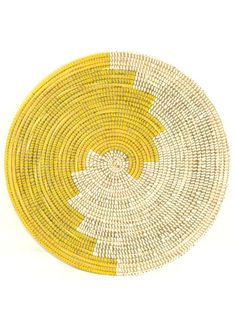 "Geometric Sun Oversize Trivet Crafted by local women living in the West African nation of Senegal, this trivet is constructed using local 'njodax' grass and plastic often recycled from rugs and prayer mats. Millet grass and plastic. 16"" diameter."